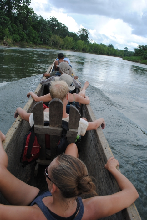 Travelling downriver via dugout canoe