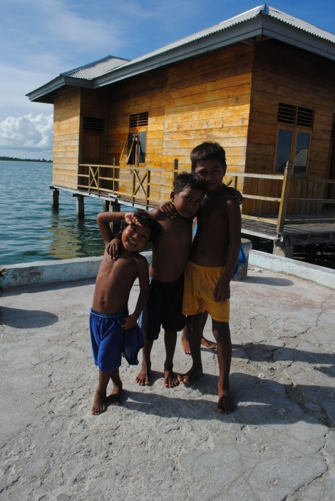 The children of Sampela are eager to greet tourists