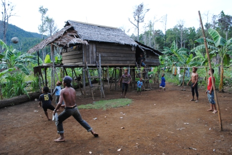 Children in the Village of Kiupoli play a hybrid version of soccer and volleyball