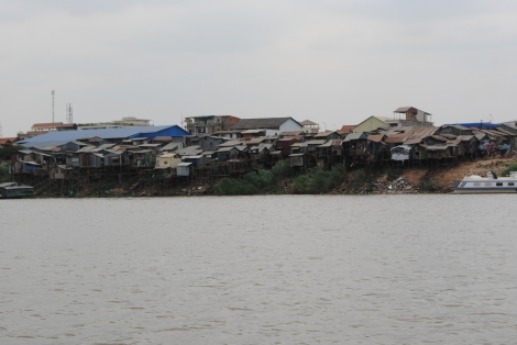 Homes jammed along the riverside on the outskirts of Phnom Penh